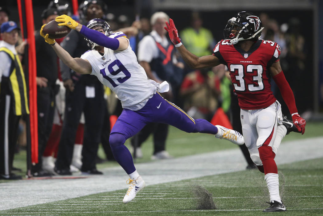 Minnesota Vikings wide receiver Adam Thielen (19) makes the catch but out of bounds against Atlanta Falcons defensive back Blidi Wreh-Wilson (33) during the first half of an NFL football game, Sun ...