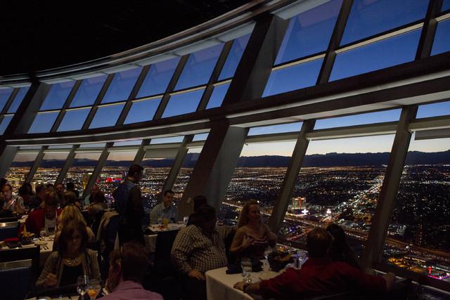Patrons enjoy a dinner as the sun sets on Tuesday, Feb. 14, 2017, at Top of the World restaurant at Stratosphere hotel-casino in Las Vegas. (Bridget Bennett/Las Vegas Review-Journal) @bridgetkbennett