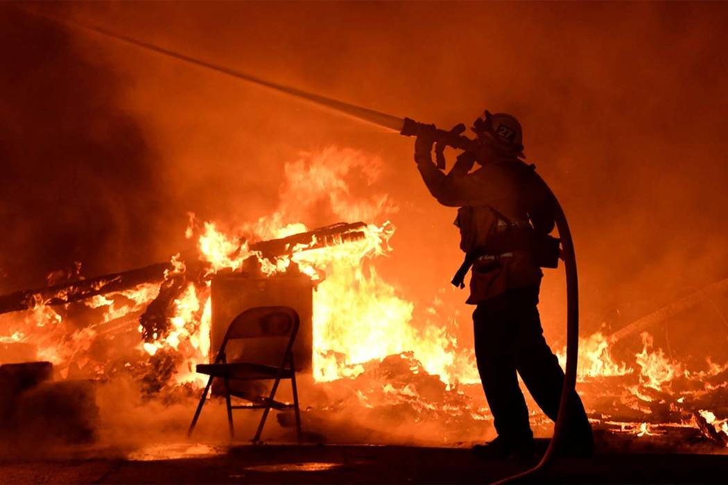 A firefighter battles flames from a Santa Ana wind-driven brush fire called the Thomas Fire in Santa Paula, California, Dec. 4, 2017. (Gene Blevins/Reuters)