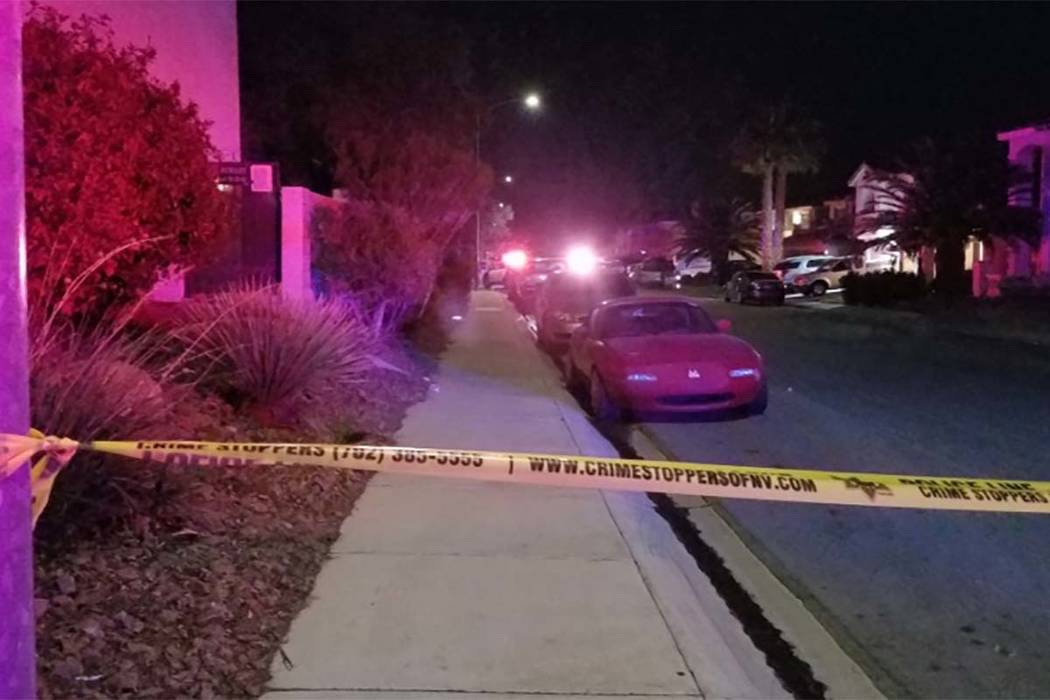 Homicide detectives investigate the shooting death of a woman in the 8500 block of Copper Knoll Avenue in northwest Las Vegas, early Tuesday, March 14, 2017. (Mike Shoro/Las Vegas Review-Journal)