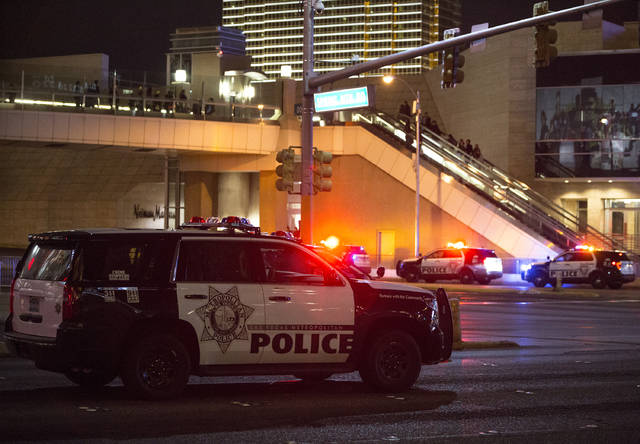 Police vehicles line the street at Las Vegas Boulevard and Spring Mountain Road on Saturday, Dec. 31, 2016, in Las Vegas. (Benjamin Hager/Las Vegas Review-Journal)