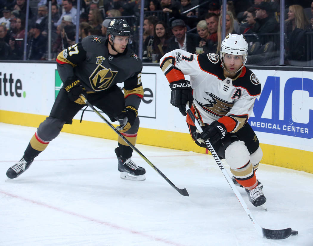 Anaheim Ducks left wing Andrew Cogliano (7) handles the puck with Vegas Golden Knights defenseman Shea Theodore (27) behind him during the second period at T-Mobile Arena in Las Vegas, Tuesday, De ...