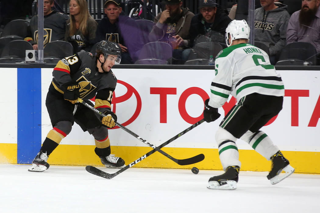 Vegas Golden Knights left wing Brendan Leipsic (13) and Dallas Stars defenseman Julius Honka (6) fight for the puck during the third period at T-Mobile Arena in Las Vegas, Tuesday, Nov. 28, 2017.  ...