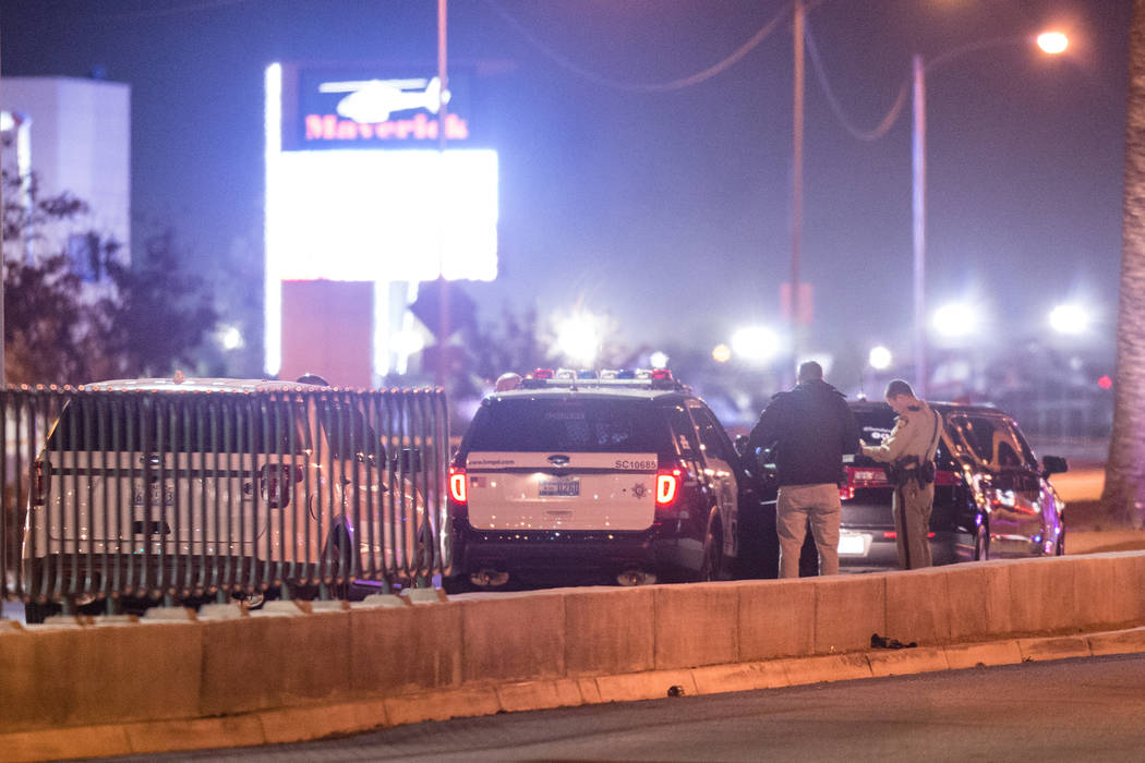 Officers investigate a crime scene where a limousine and motorcycle crashed leaving at least one person dead on Las Vegas Boulevard just south of the Welcome to Fabulous Las Vegas sign in Las Vega ...