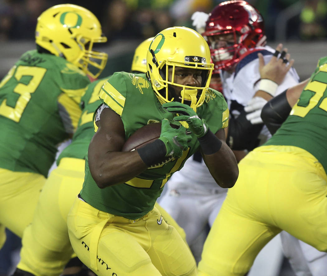 Oregon running back Royce Freeman breaks for a touchdown against Arizona during the first quarter of an NCAA college football game Saturday, Nov. 18, 2017, in Eugene, Ore. (AP Photo/Chris Pietsch)