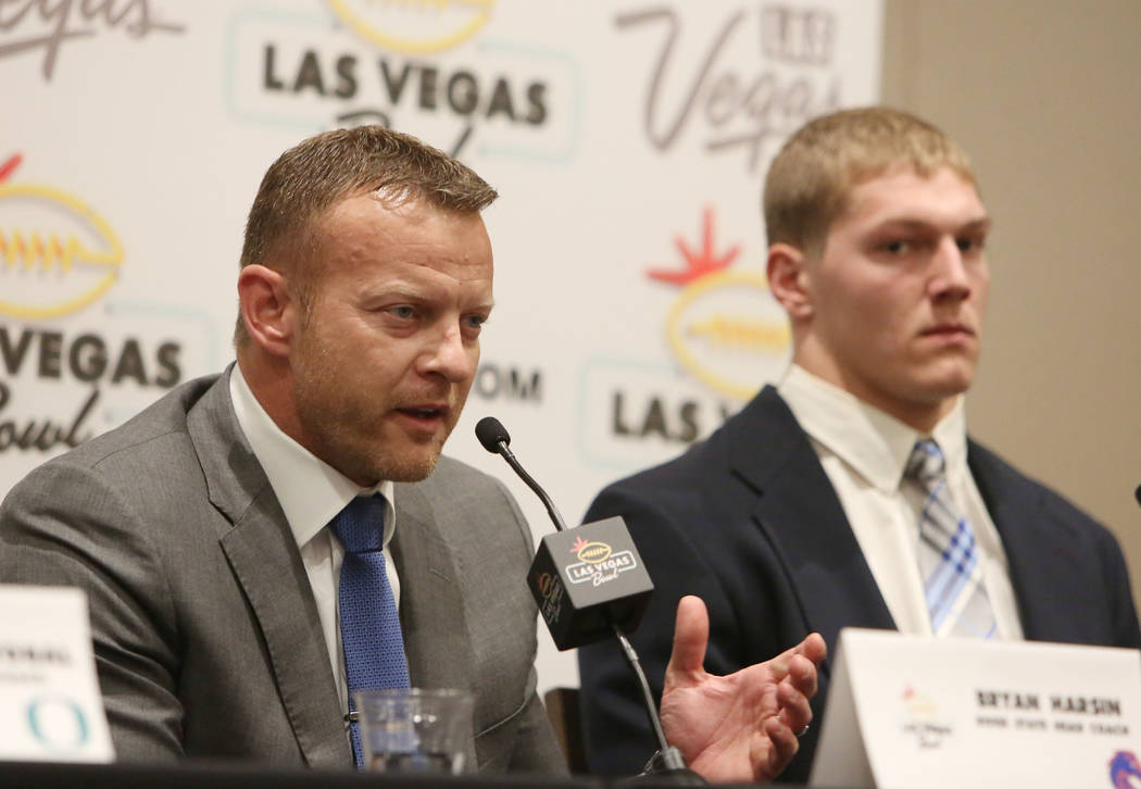 Boise State linebacker Vander Esch, right, listens as head coach Bryan Harsin speaks during a Las Vegas Bowl press conference at the Hard Rock hotel-casino on Friday, Dec. 15, 2017, in Las Vegas.  ...