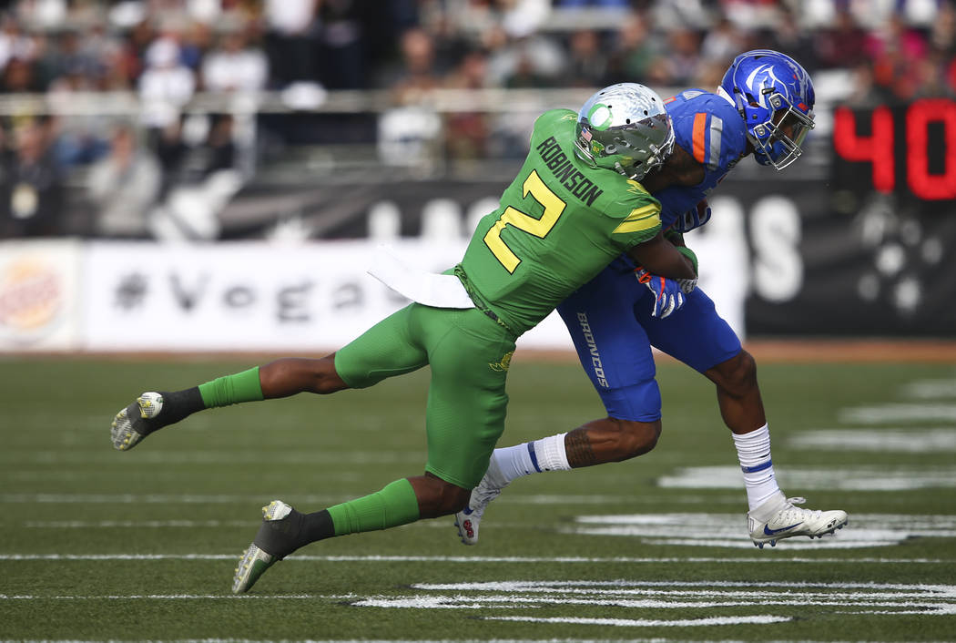 Boise State's Cedrick Wilson (1) is tackled by Oregon's Tyree Robinson (2) during the Las Vegas Bowl at Sam Boyd Stadium in Las Vegas on Saturday, Dec. 16, 2017. Chase Stevens Las Vegas Review-Jou ...