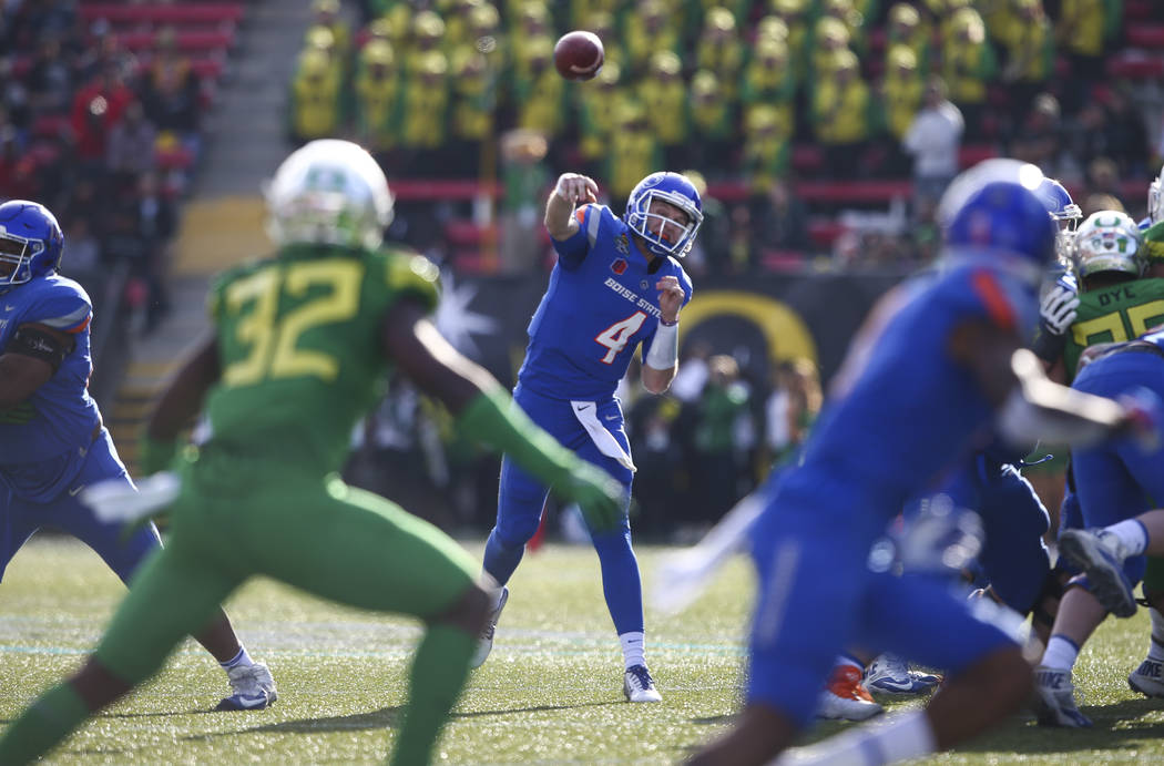 Boise State's Brett Rypien (4) throws a pass while playing Oregon during the Las Vegas Bowl at Sam Boyd Stadium in Las Vegas on Saturday, Dec. 16, 2017. Chase Stevens Las Vegas Review-Journal @css ...