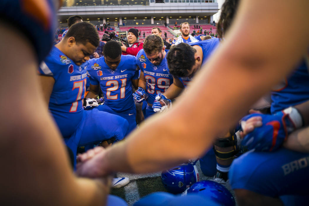 Boise State players join together for a moment of prayer after defeating Oregon in the Las Vegas Bowl at Sam Boyd Stadium in Las Vegas on Saturday, Dec. 16, 2017. Chase Stevens Las Vegas Review-Jo ...