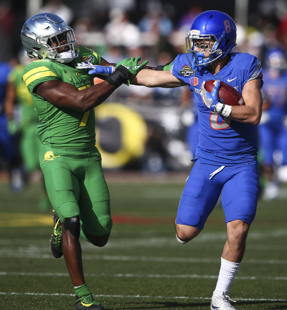 Boise State's Sean Modster (8) runs the ball as Oregon's Ugochukwu Amadi (7) tries to tackle during the Las Vegas Bowl at Sam Boyd Stadium in Las Vegas on Saturday, Dec. 16, 2017. Chase Stevens La ...