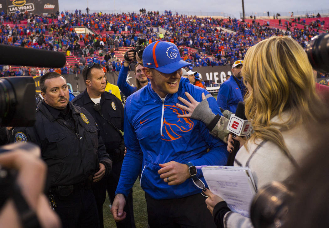 Boise State head coach Bryan Harsin celebrates with his family after defeating Oregon in the Las Vegas Bowl at Sam Boyd Stadium in Las Vegas on Saturday, Dec. 16, 2017. Chase Stevens Las Vegas Rev ...