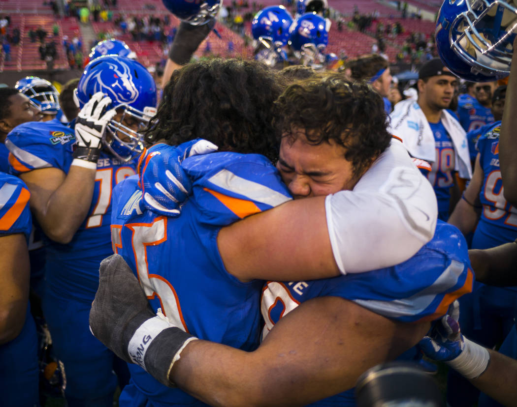 Boise State's David Moa (55) and Sonatane Lui (98) celebrate after defeating Oregon in the Las Vegas Bowl at Sam Boyd Stadium in Las Vegas on Saturday, Dec. 16, 2017. Chase Stevens Las Vegas Revie ...