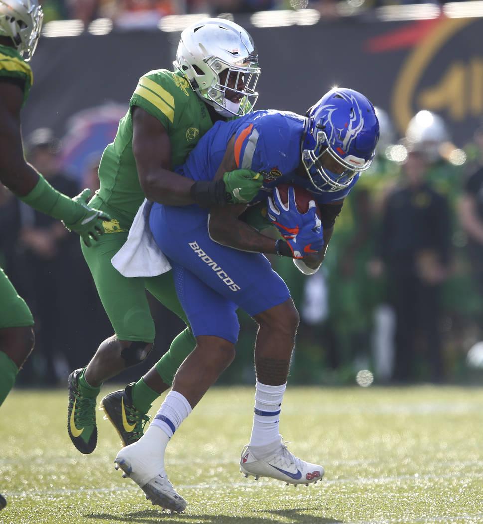 Oregon's Ugochukwu Amadi (7) takes down Boise State's Cedrick Wilson (1) during the Las Vegas Bowl at Sam Boyd Stadium in Las Vegas on Saturday, Dec. 16, 2017. Chase Stevens Las Vegas Review-Journ ...