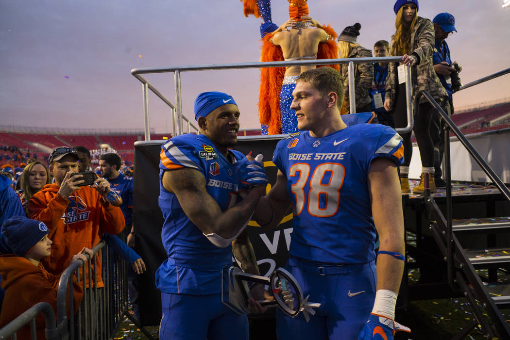 Boise State's Cedrick Wilson (1) and Leighton Vander Esch (38) celebrate their win over Oregon in the Las Vegas Bowl at Sam Boyd Stadium in Las Vegas on Saturday, Dec. 16, 2017. Chase Stevens Las  ...
