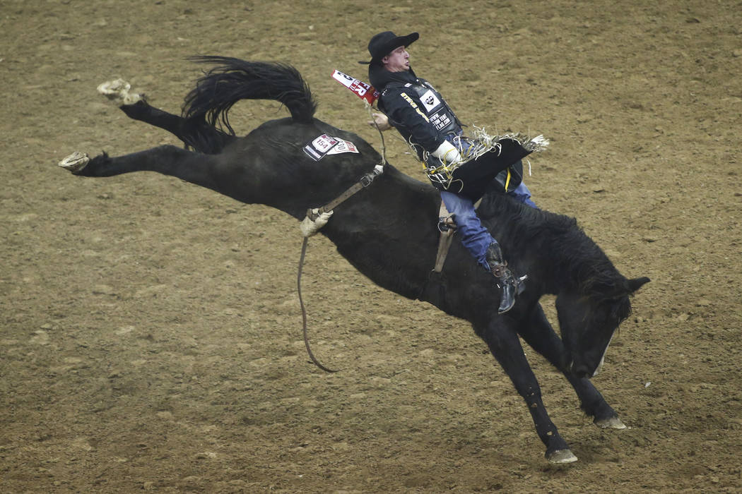 Jake Vold of Alberta, Canada rides on Oakridge while competing in the bareback riding during the opening night of the National Finals Rodeo at the Thomas & Mack Center in Las Vegas on Thursday ...