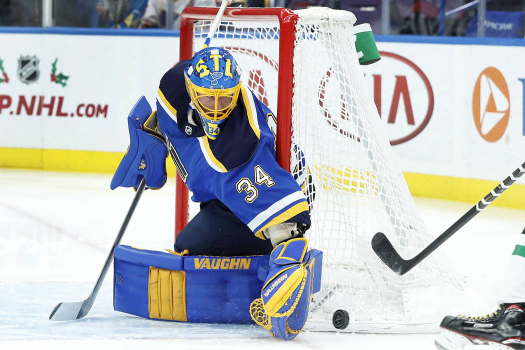 St. Louis Blues goalie Jake Allen watches the puck slide past during the first period of an NHL hockey game against the Dallas Stars, Thursday, Dec. 7, 2017, in St. Louis. Blues season-ticket hold ...
