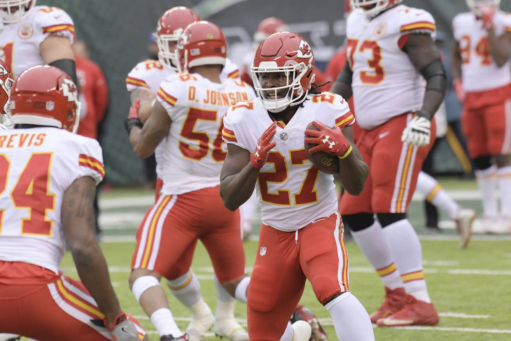 Kansas City Chiefs' Kareem Hunt (27) warms-up before an NFL football game between the Kansas City Chiefs and the New York Jets, Sunday, Dec. 3, 2017, in East Rutherford, N.J. (AP Photo/Bill Kostroun)