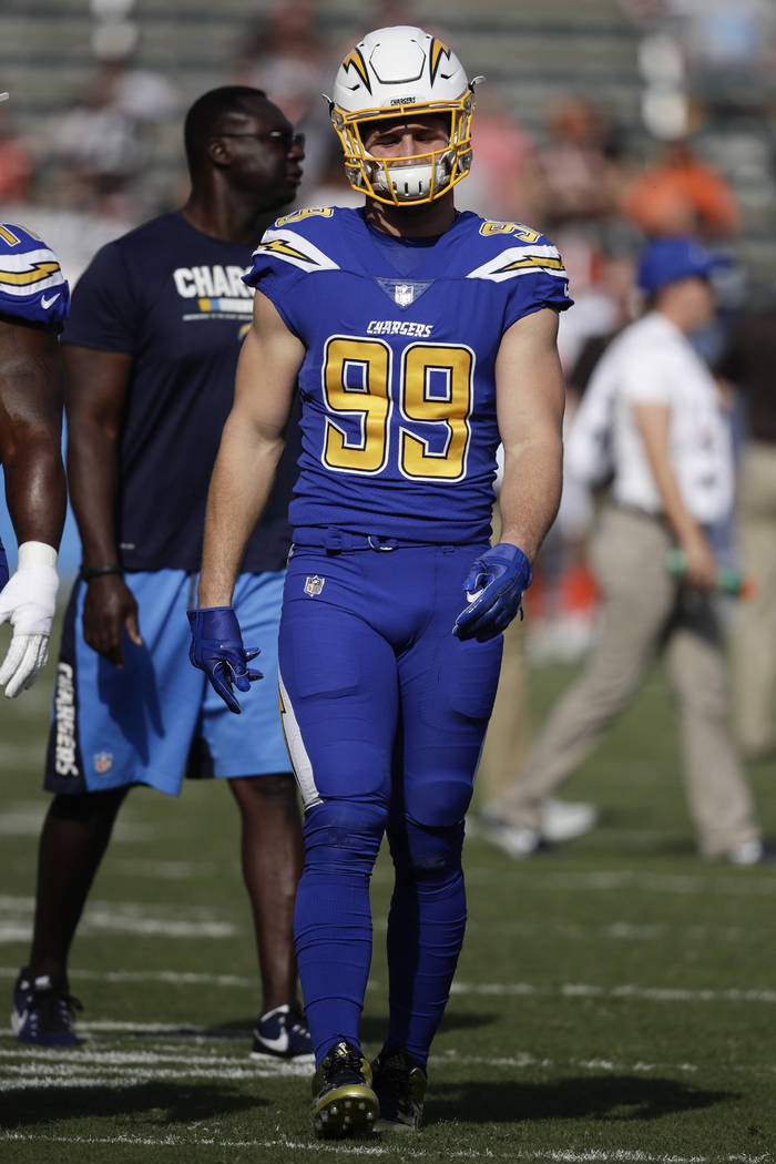 Los Angeles Chargers defensive end Joey Bosa watches during warm ups before an NFL football game against the Cleveland Browns Sunday, Dec. 3, 2017, in Carson, Calif. (AP Photo/Jae C. Hong)