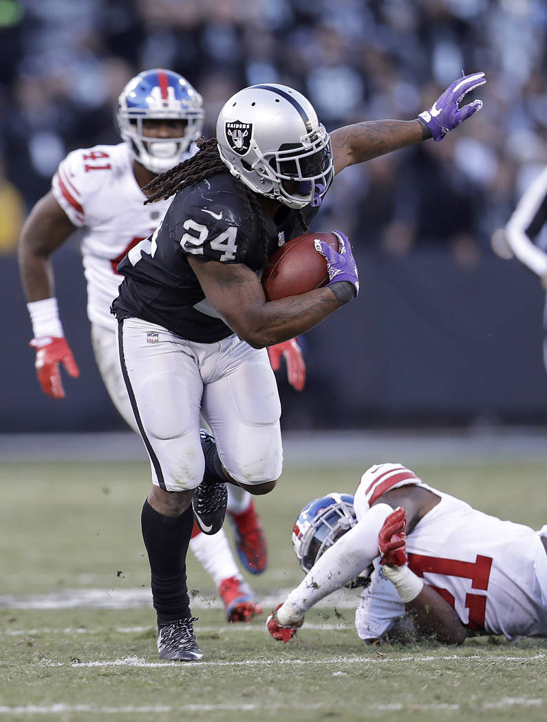 Oakland Raiders running back Marshawn Lynch (24) runs against the New York Giants during an NFL football game in Oakland, Calif., Sunday, Dec. 3, 2017. (AP Photo/Marcio Jose Sanchez)