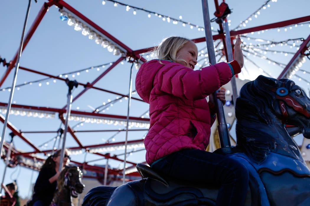 A girl rides a carousel duringWinterFestoutside City Hall in Henderson, Saturday, Dec. 9, 2017. Joel Angel Juarez Las Vegas Review-Journal @jajuarezphoto