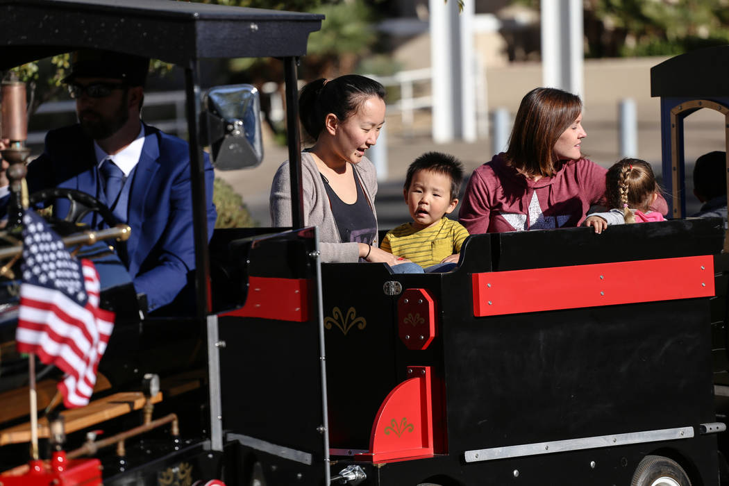 Agiimaa Tsogt, 27, left, and her son Chase, 2, second from left, ride a miniature train with Ashley Hinton, 32, second from right, and her daughter Hailey, 3, right, all of Henderson, during ...