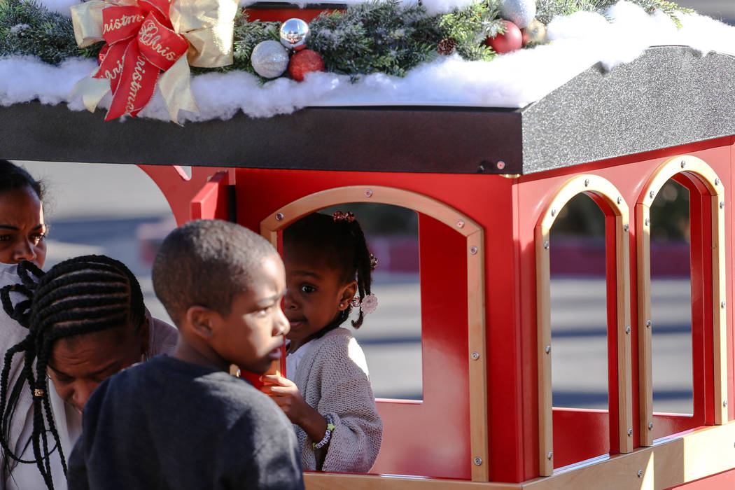 Noelle Smith of North Las Vegas, 4, rides a miniature train duringWinterFestoutside City Hall in Henderson, Saturday, Dec. 9, 2017. Joel Angel Juarez Las Vegas Review-Journal @jajuarez ...