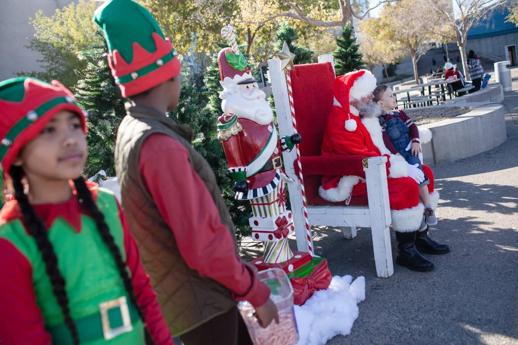 Gavyn Ward of Las Vegas, 4, sits on Santa Claus' lap duringWinterFestoutside City Hall in Henderson, Saturday, Dec. 9, 2017. Joel Angel Juarez Las Vegas Review-Journal @jajuarezphoto