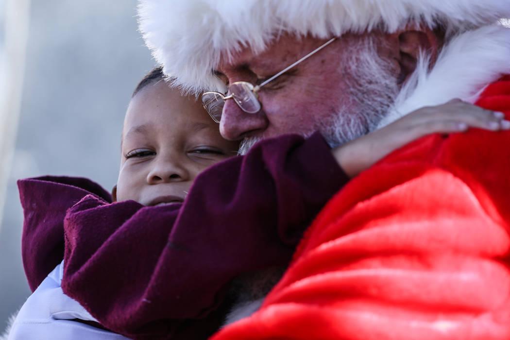 Jeremiah Porter of Henderson, 5, left, hugs Santa Claus, right, duringWinterFestoutside City Hall in Henderson, Saturday, Dec. 9, 2017. Joel Angel Juarez Las Vegas Review-Journal @jaju ...