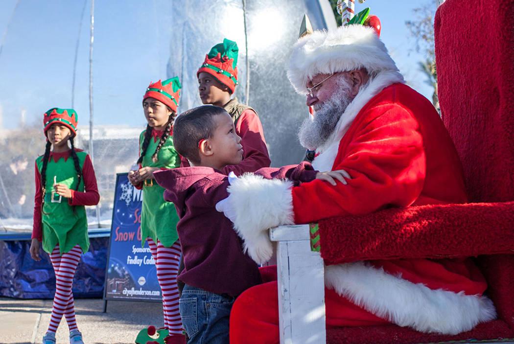 Jeremiah Porter of Henderson, 5, left, speaks with Santa Claus, right, duringWinterFestoutside City Hall in Henderson, Saturday, Dec. 9, 2017. Joel Angel Juarez Las Vegas Review-Journa ...