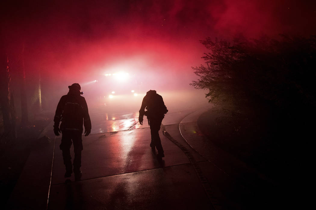 Firefighters battle the Lilac fire in Bonsai, Calif., on Friday, Dec. 8, 2017. The blaze burned numerous structures and thousands of acres according to fire officials. Wind-swept blazes have force ...