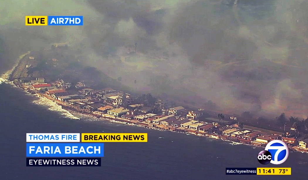 This aerial view from video provided by KABC-TV shows flames from a wildfire bearing down on homes on Faria Beach just outside Ventura, Calif., Thursday, Dec. 7, 2017. It appeared that firefighter ...
