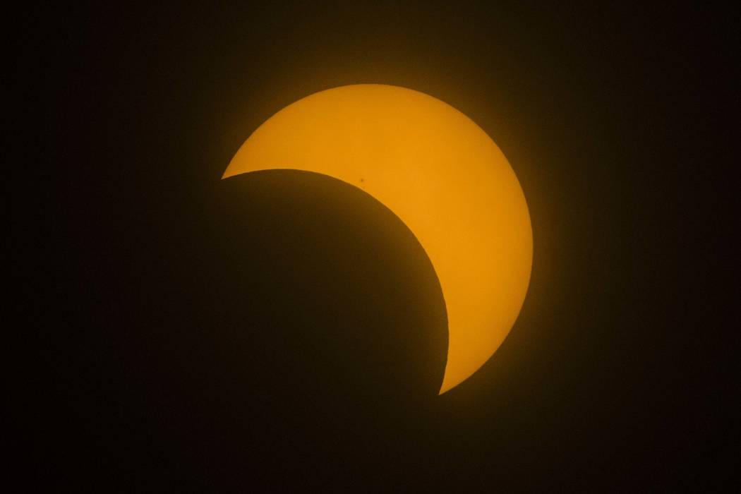 The moon passes by the sun during a partial solar eclipse in Las Vegas on Monday, Aug. 21, 2017. (Chase Stevens/Las Vegas Review-Journal) @csstevensphoto