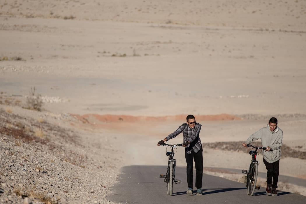 Adrian Gamez, 14, left, and Brighton McDonald, 15, right, both of Las Vegas, walk their bikes uphill as they ride around Majestic Park in Las Vegas, Friday, Dec. 8, 2017. Joel Angel Juarez Las Veg ...