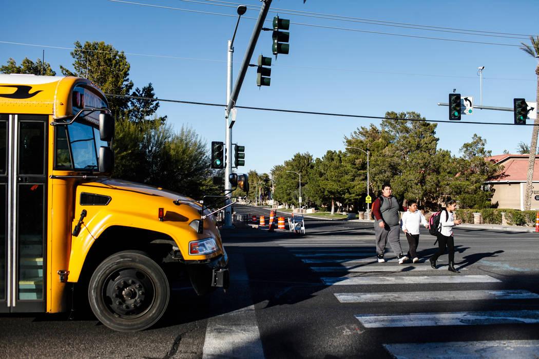 Children cross Rock Springs Drive as they walk home from school in Las Vegas, Friday, Dec. 8, 2017. Joel Angel Juarez Las Vegas Review-Journal @jajuarezphoto