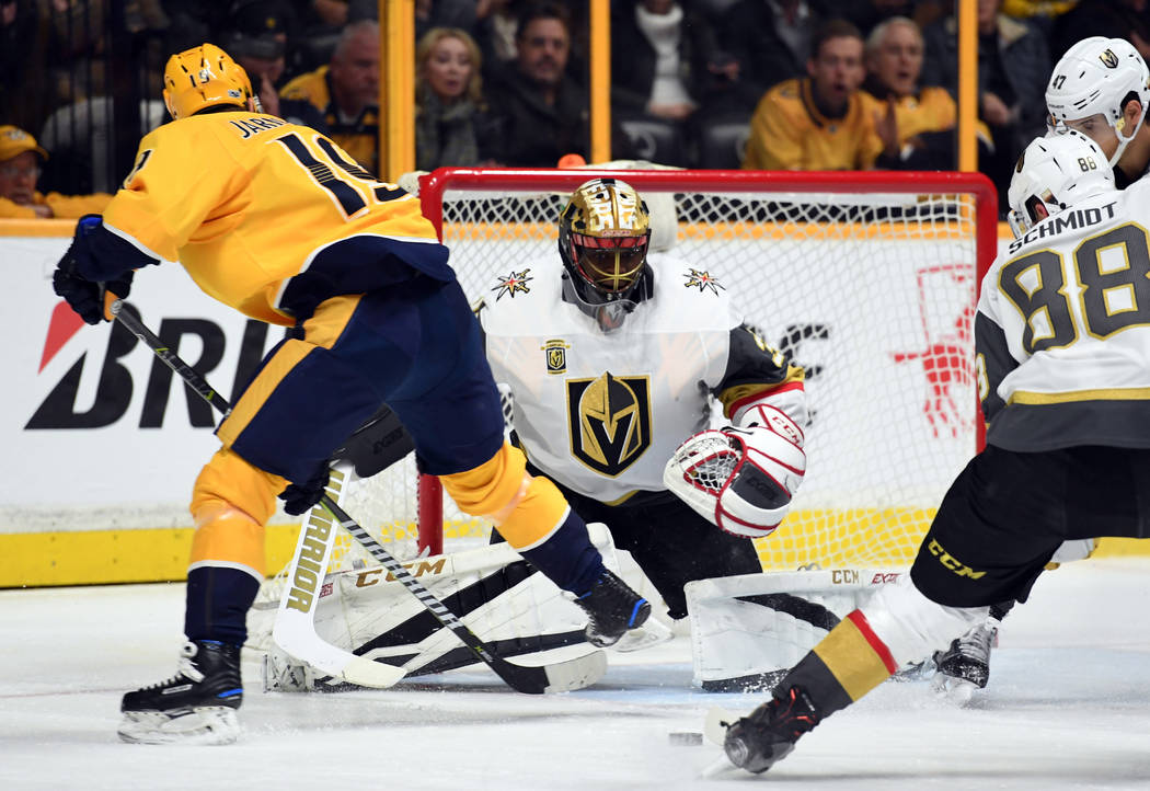 Dec 8, 2017; Nashville, TN, USA; Vegas Golden Knights goalie Malcolm Subban (30) makes a save on a shot by Nashville Predators center Calle Jarnkrok (19) during the first period at Bridgestone Are ...
