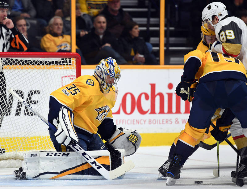 Dec 8, 2017; Nashville, TN, USA; Nashville Predators goalie Pekka Rinne (35) makes a save on a shot by Vegas Golden Knights right wing Alex Tuch (89) during the second period at Bridgestone Arena. ...