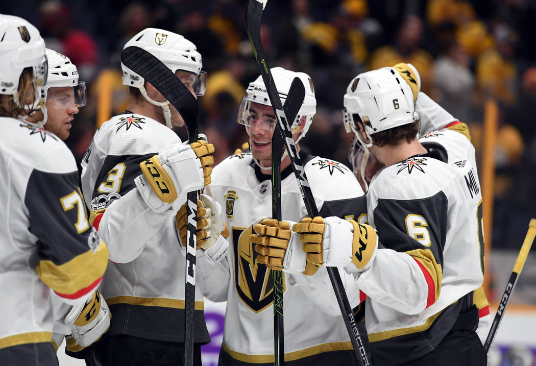 Dec 8, 2017; Nashville, TN, USA; Vegas Golden Knights right wing Reilly Smith (19) celebrates with teammates after a shootout win against the Nashville Predators at Bridgestone Arena. Mandatory Cr ...