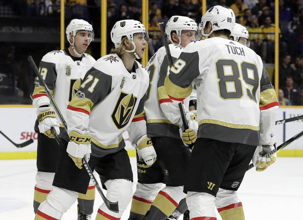 Vegas Golden Knights center William Karlsson (71), of Sweden, celebrates with teammates after scoring a goal against the Nashville Predators during the first period of an NHL hockey game Friday, D ...
