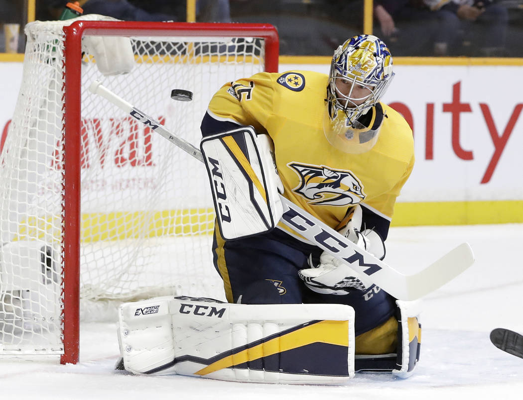 Nashville Predators goalie Pekka Rinne, of Finland, blocks a shot by the Vegas Golden Knights during the first period of an NHL hockey game Friday, Dec. 8, 2017, in Nashville, Tenn. (AP Photo/Mark ...