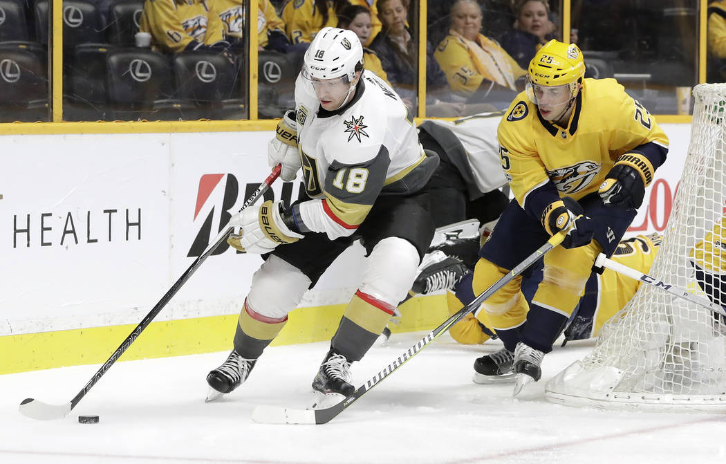 Vegas Golden Knights left wing James Neal (18) moves the puck ahead of Nashville Predators defenseman Alexei Emelin (25), of Russia, during the first period of an NHL hockey game Friday, Dec. 8, 2 ...