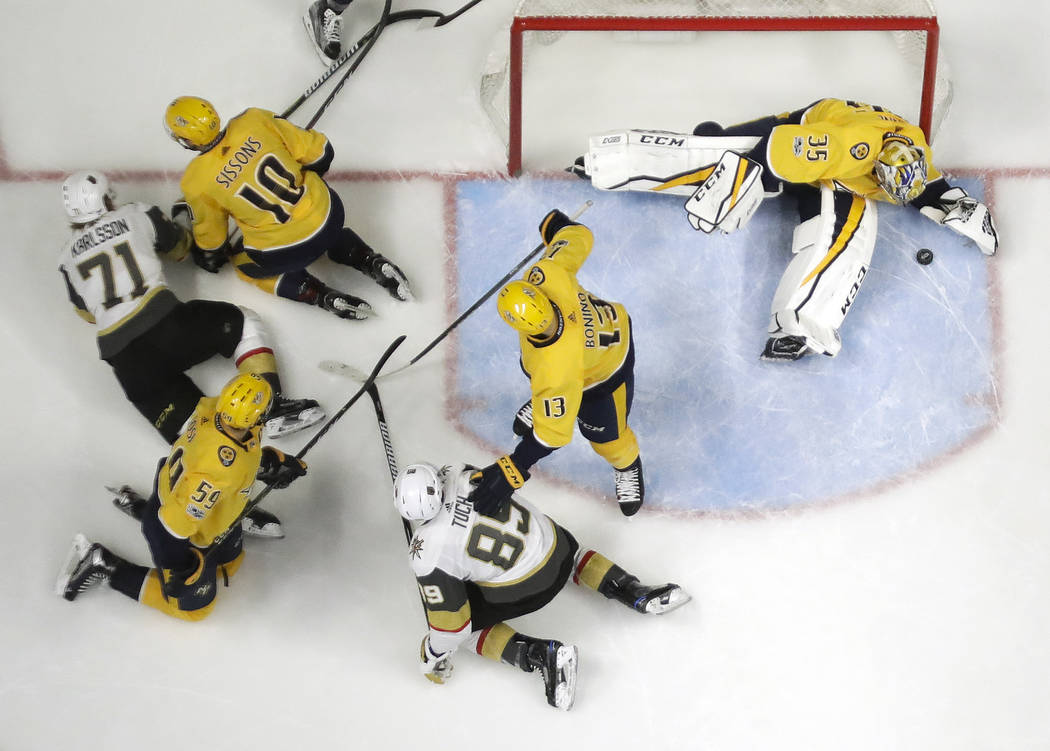 Nashville Predators goalie Pekka Rinne (35), of Finland, blocks a shot by the Vegas Golden Knights during the second period of an NHL hockey game Friday, Dec. 8, 2017, in Nashville, Tenn. (AP Phot ...