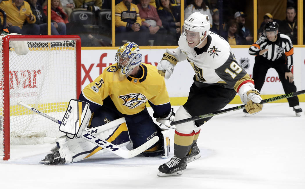 Vegas Golden Knights right wing Reilly Smith (19) celebrates after scoring against Nashville Predators goalie Pekka Rinne (35), of Finland, for the only goal of the shootout in an NHL hockey game  ...
