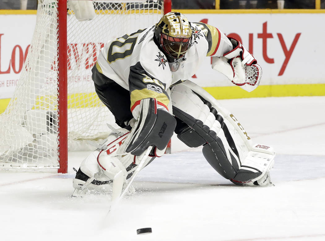 Vegas Golden Knights goalie Malcolm Subban makes a stop against the Nashville Predators during the second period of an NHL hockey game Friday, Dec. 8, 2017, in Nashville, Tenn. (AP Photo/Mark Hump ...