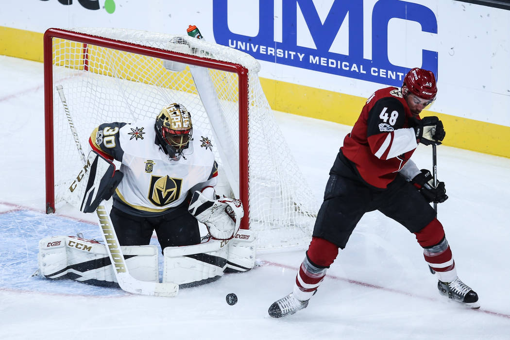 Vegas Golden Knights goalie Malcolm Subban (30), left, blocks a shot from Arizona Coyotes left wing Jordan Martinook (48), right, during the first period of a hockey game at T-Mobile Arena in Las  ...