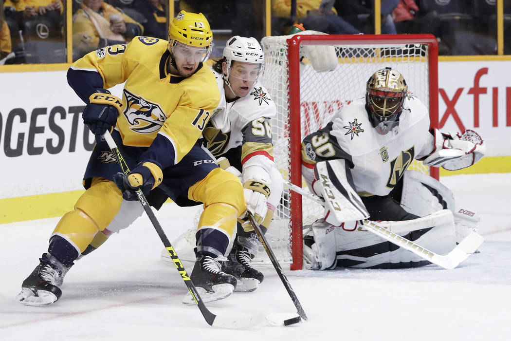 Nashville Predators defenseman Nick Bonino (13) skates around the net as Vegas Golden Knights left wing Erik Haula (56), of Finland, and goalie Malcolm Subban (30) defend during the second period  ...