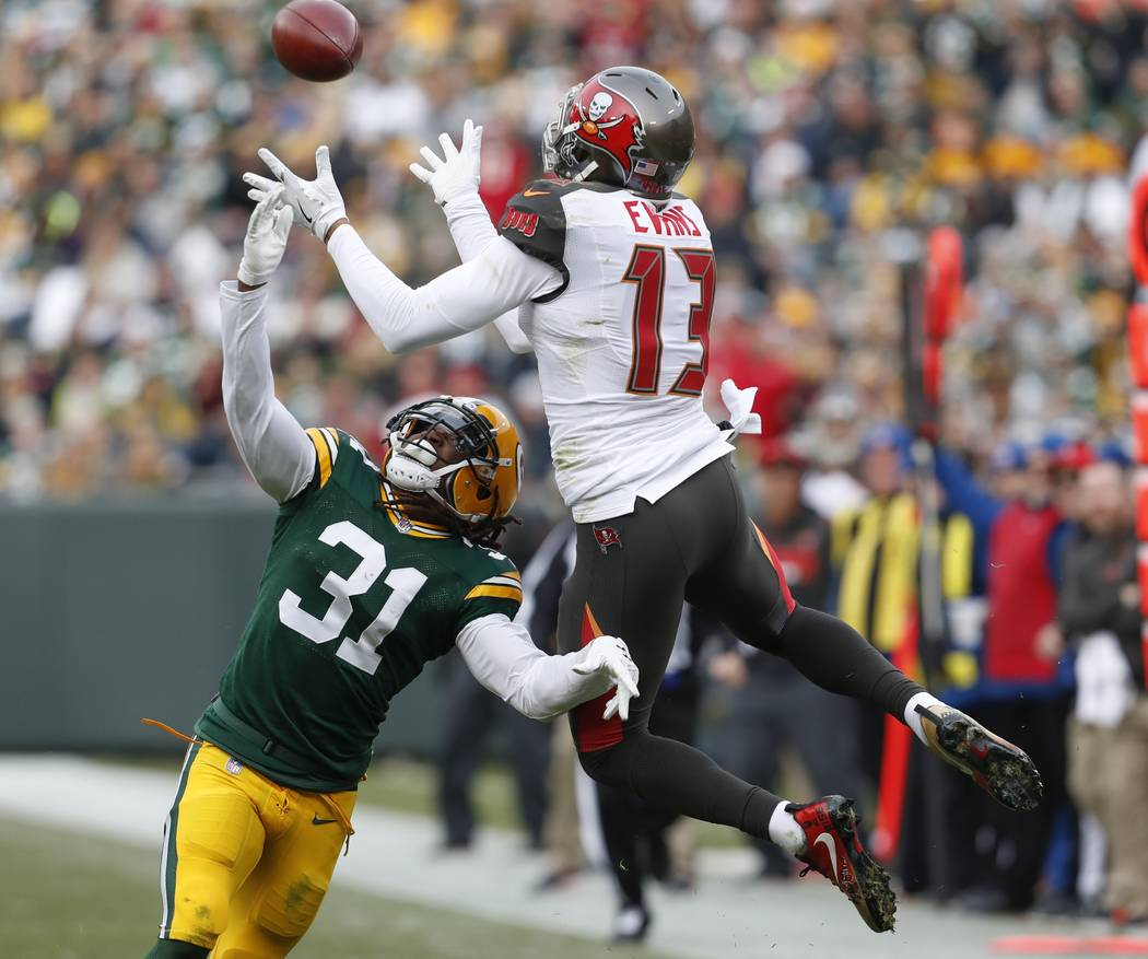 Tampa Bay Buccaneers' Mike Evans catches a pass over Green Bay Packers' Davon House during the first half of an NFL football game Sunday, Dec. 3, 2017, in Green Bay, Wis. (AP Photo/Matt Ludtke)
