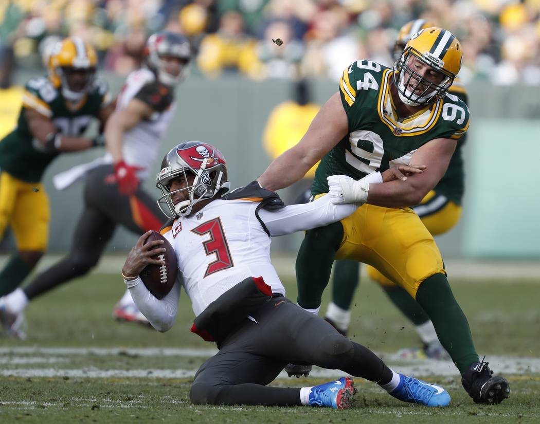 Green Bay Packers' Dean Lowry sacks Tampa Bay Buccaneers' Jameis Winston during the second half of an NFL football game Sunday, Dec. 3, 2017, in Green Bay, Wis. (AP Photo/Matt Ludtke)