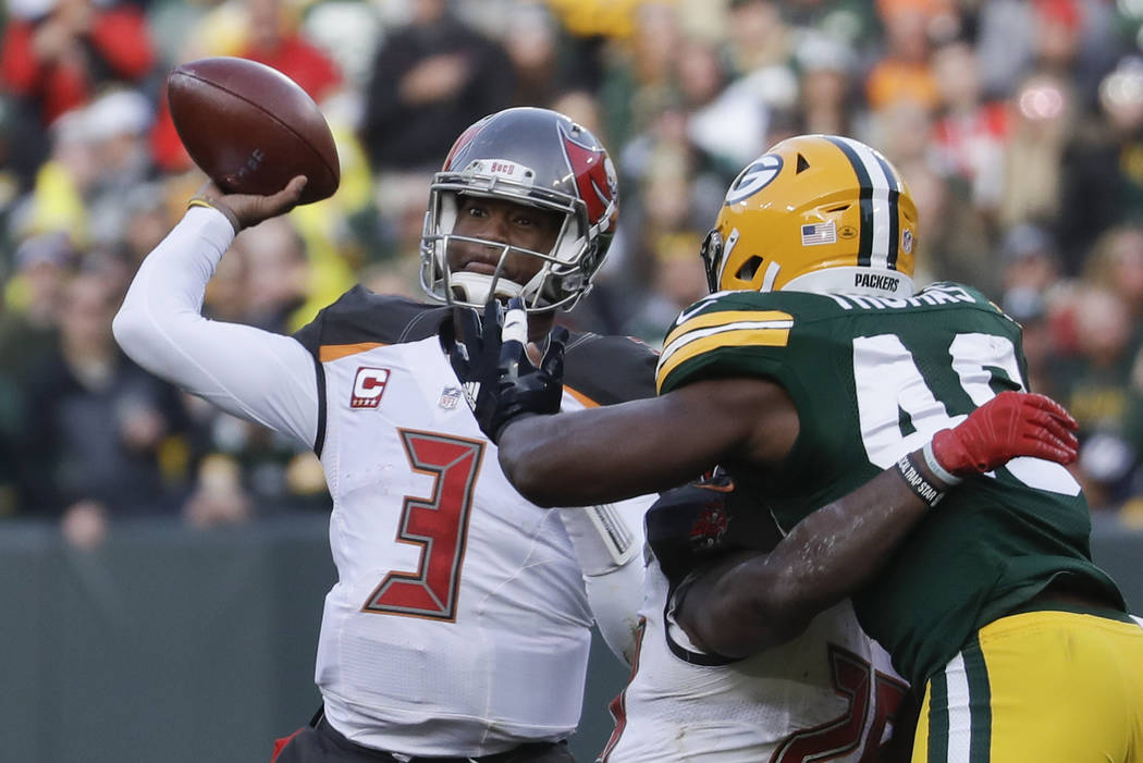 Tampa Bay Buccaneers' Jameis Winston throws during the second half of an NFL football game against the Green Bay Packers Sunday, Dec. 3, 2017, in Green Bay, Wis. (AP Photo/Morry Gash)