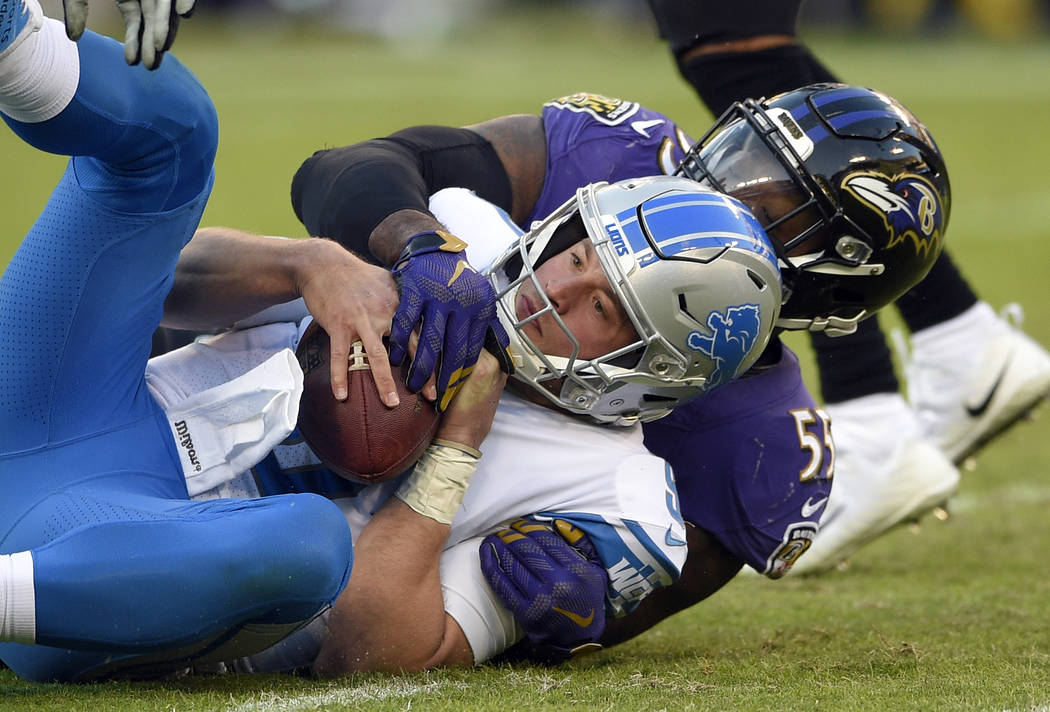 Detroit Lions quarterback Matthew Stafford is sacked by Baltimore Ravens outside linebacker Terrell Suggs in the second half of an NFL football game, Sunday, Dec. 3, 2017, in Baltimore. (AP Photo/ ...