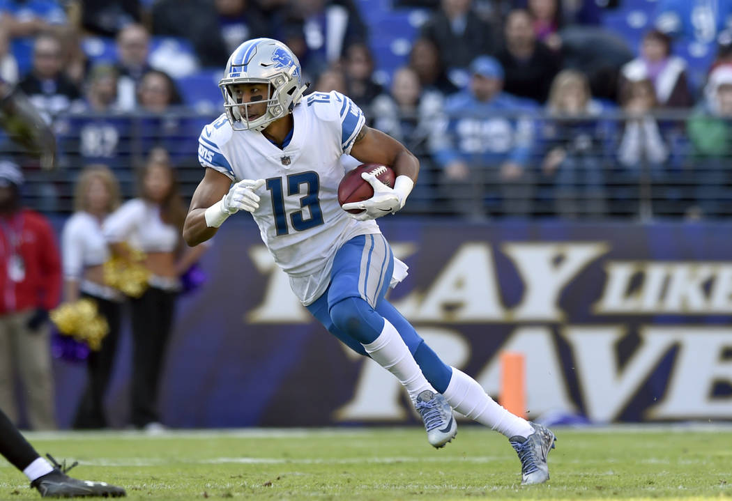 Detroit Lions wide receiver T.J. Jones rushes the ball in the first half of an NFL football game against the Baltimore Ravens, Sunday, Dec. 3, 2017, in Baltimore. (AP Photo/Gail Burton)